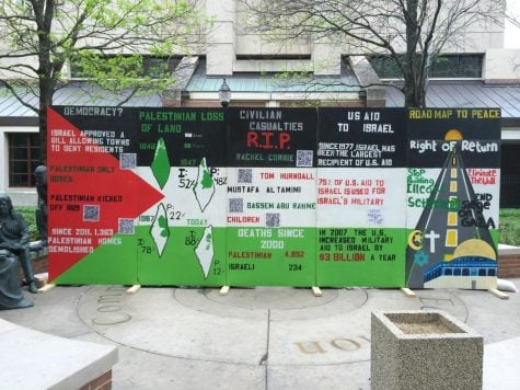 "SJP's ""mock apartheid wall"" in St. Vincent's Circle just off the Lincoln Park Campus Quad aimed to raise awareness about the Israeli-Palestinian conflict last week. Photo by Amanda Driscoll."