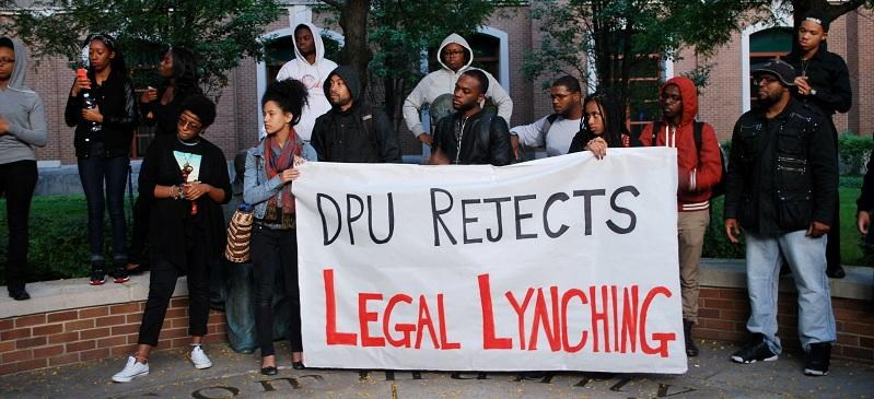 DePaul student groups protest police-instigated violence against young men. (Christian Ianiello / The DePaulia)