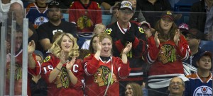 Chicago Blackhawks fans celebrate a goal against the Edmonton Oilers in preseason action. (Liam Richards / AP)