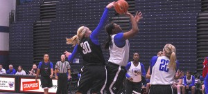 DePaul forward Megan Podkowa blocks forward Brandi Harvey-Carr on a layup attempt. (Maggie Gallagher / The DePaulia)