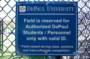 A sign at Wish Field states that the field is reserved for DePaul students and personnel only with a valid id. (Parker Asmann / The DePaulia)