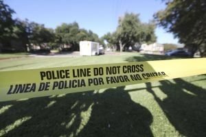 A police line tape marks where the media is set up to watch The Village Bend East apartments where a second healthcare worker lives that tested positive for Ebola, Wednesday, Oct. 15, 2014, in Dallas. Photo courtesy AP.