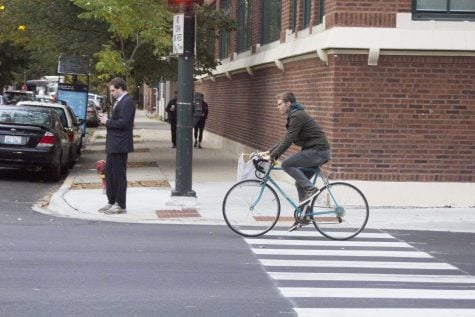 A biker riding down Fullerton Avenue. Many students use biking as a way to get around campus. Photo by Carlyn Duff/The DePaulia