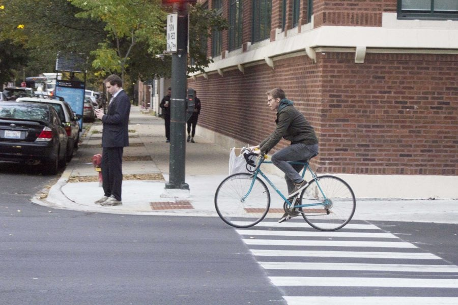 A+biker+riding+down+Fullerton+Avenue.+Many+students+use+biking+as+a+way+to+get+around+campus.+Photo+by+Carlyn+Duff%2FThe+DePaulia