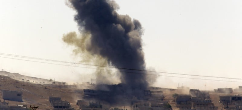 In this Oct. 6, 2014 file photo, smoke rises after a shell lands in Kobani in Syria as fighting intensifies between Syrian Kurds and the militants of Islamic State group, as seen from the outskirts of Suruc, at the Turkey-Syria border. After two months, the U.S.-led aerial campaign in Iraq has so far hardly dented the core of the Islamic State group's territory. The extremists' grip on major cities across Iraq and neighboring Syria remains unquestioned. The campaign has brought some gains, with Kurdish fighters taking back towns on the fringes of the Islamic State group's territory. But those successes only underline a major weakness: Besides the Iraqi Kurds, there are no forces on the ground ready to capitalize on the airstrikes. (AP Photo/Lefteris Pitarakis)