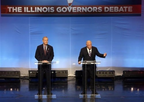 Illinois gubernatorial candidates Republican Bruce Rauner, left, and Democrat Gov. Pat Quinn participate in a debate at the DuSable Museum of African American History, Tuesday, Oct. 14, 2014, in Chicago. The debate is expected to focus on black voters. (AP Photo/Charles Rex Arbogast)