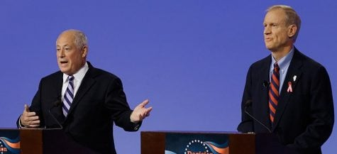 Gov. Pat Quinn and Bruce Rauner debate in Peoria a few weeks ago. Experts have deemed this race too close to call. Over the past few weeks, every poll has shown a statistical tie. (Seth Perlman | AP)