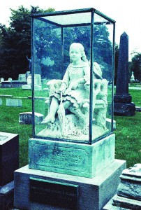The statue of Inez Clarke, a young girl killed by a lightning strike, at Graceland Cemetery. Many visitors to the cemetery claimed they have seen a young girl playing near the statue. (Giovanni Lenski / The DePaulia)