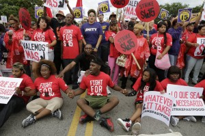 Fast food workers in Chicago block 87th Street in their effort to increase the minimum wage on Sept. 4. Photo courtesy Michael Tercha | Tribune News Service