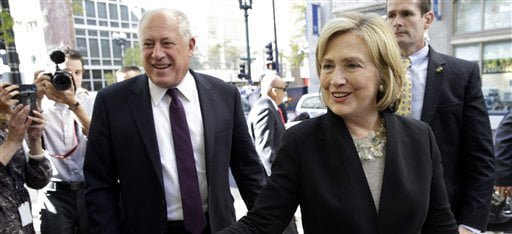 Former U.S. Secretary of State Hillary Rodham Clinton, right, and Illinois Gov. Pat Quinn, left, talk with supporters  as they arrive at a Barnes & Noble bookstore in Chicago Wednesday, Oct. 8, 2014. Clinton visited Chicago for two appearances, including a speech to a business group, and she is expected to stump for Quinn in his bid for re-election. (AP Photo/ Nam Y. Huh)
