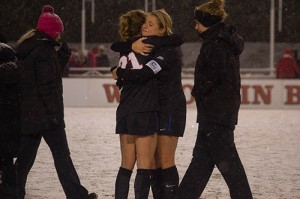 Junior captain Elise Wyatt hugs sophomore Abby Reed after their loss to Wisconsin. (Grant Myatt / The DePaulia)