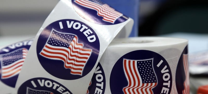 Stickers await voters after they cast their votes on Election Day at Glenwood Center in Greensboro, N.C., Tuesday, Nov. 4, 2014. (AP Photo/Gerry Broome)