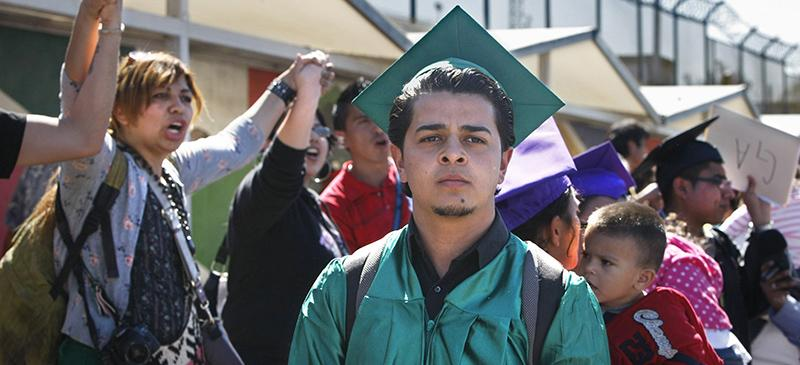 Jaren Rodriguez, 20, at a rally in Tijuana, Mexico, organized by the National Immigrant Youth Alliance that hopes to bring families back to their homes in the United States. He was brought to the United States when he was four and graduated from high school in San Jose, Calif. He later self-deported in an attempt to legalize his immigration status. (Don Bartletti | Tribune News Service / Los Angeles Times)
