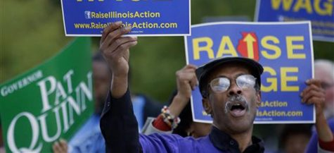 A referenda question that asked Illinoisans if the minimum wage should be raised passed with more than two-thirds support. (Seth Perlman | AP)