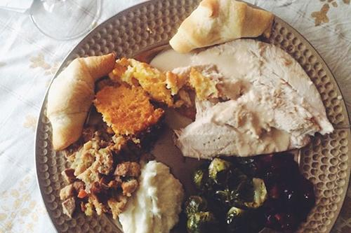 My Thanksgiving plate included: turkey, garlic mashed potatoes, stuffing, roasted Brussles sprouts, cranberries with walnuts, spoonbread and cresent rolls (you can't make everything from scratch).