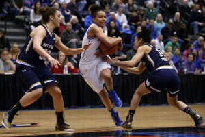 DePaul guard Brittany Hrynko (12) pushes through Notre Dame forward Kathryn Westbeld, left, and guard Mychal Johnson, right, during the second half of an NCAA college basketball game on Wednesday, Dec. 10, 2014, in Chicago. (AP Photo/Andrew A. Nelles)