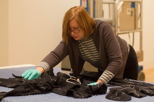 "Interim director Laura Fatemi, who began her position at the beginning of the year, prepares a piece for ""Rooted in Soil.""  (Grant Myatt / The DePaulia)"