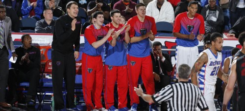 From left to right: Peter Ryckbosch, Cory Dolins, David Molinari and Joe Hanel make up the self-proclaimed Bench Mob providing support and enthusiasm to their team. (Photo courtesy of DePaul Athletics)