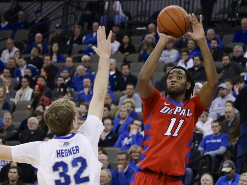 DePaul's Forrest Robinson (11) shoots a 3-pointer over Creighton's Toby Hegner during the first half of an NCAA college basketball game in Omaha, Neb., Wednesday, Jan. 7, 2015. (AP Photo/Nati Harnik)