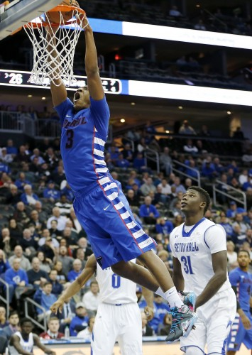 DePaul forward Rashaun Stimage dunks against Seton Hall during the first half of an NCAA college basketball game, Thursday, Jan. 22, 2015, in Newark, N.J. (AP Photo/Julio Cortez)