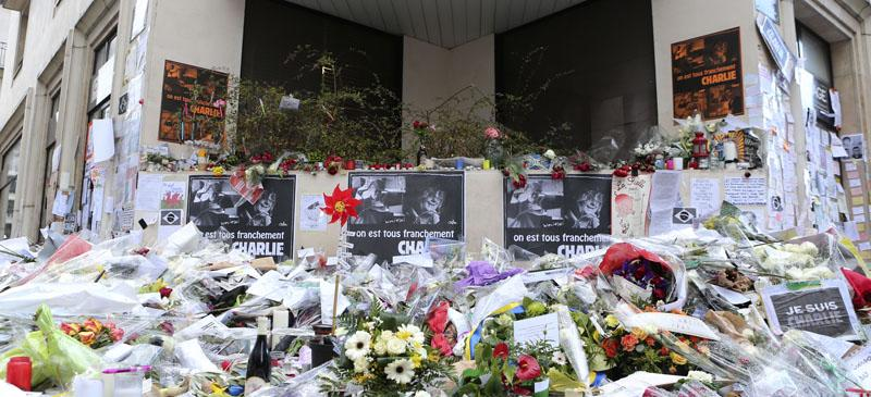 Flowers lay outside Charlie Hebdo headquarters in Paris, France on Jan. 14 after the terrorist attack. Since then, 54 people have been arrested for hate speech and anti-Semitism. (Jacques Brinon | AP)
