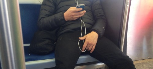 """A CTA passenger takes up more than one seat in an act that has come to be called """"manspreading."""" Some argue the action demonstrates that some men think they can take up more physical space than women. (Courtney Jacquin / The DePaulia)"""