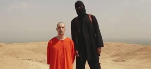 This image from a video released by Islamic State militants on Aug. 19, shows journalist James Foley before his killing by Islamic State militants. (AP File Photo)