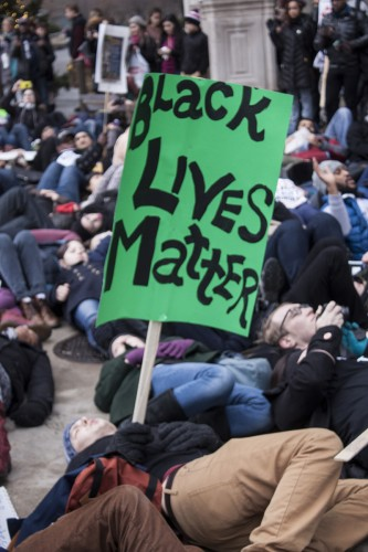 "People participate in a ""die-in"" during the march. (Kevin Gross / The DePaulia)"