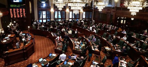 The Illinois House of Representatives during a special session last week. Members voted on legislation to set a 2016 special election for office of comptroller, one of many laws passed over the past year. (Seth Perlman | AP)