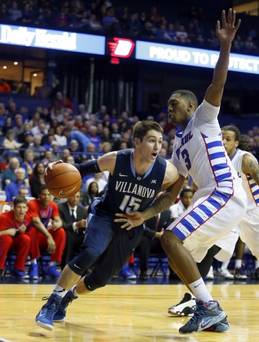 Villanova guard Ryan Arcidiacono (15) dribbles past DePaul forward Rashaun Stimage (3) during the first half of an NCAA college basketball game, Saturday, Jan. 31, 2015, in Rosemont, Ill. (AP Photo/Jeff Haynes)