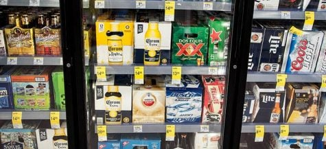 Cases of beer stacked in a cooler at Walgreen's.
