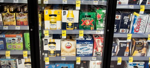 Cases of beer stacked in a cooler at Walgreen's. Some DePaul students use fake IDs to purchase alcohol or go to bars. (Maggie Gallagher / The DePaulia)