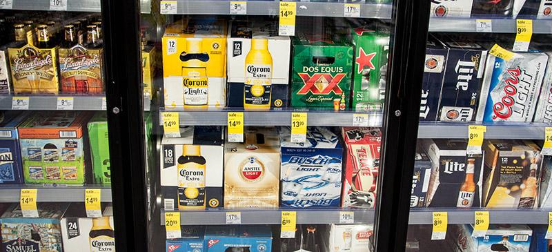 Cases+of+beer+stacked+in+a+cooler+at+Walgreen%E2%80%99s.+