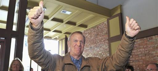 Bruce Rauner gives a thumbs up to a crowd at an event in Moline last Saturday. (AP Photo/The Dispatch, Paul Colletti)