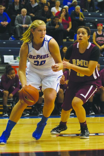 DePaul forward Megan Podkowa drives to the basket on Nov. 6 against Robert Morris University.  (Grant Myatt / The DePaulia)