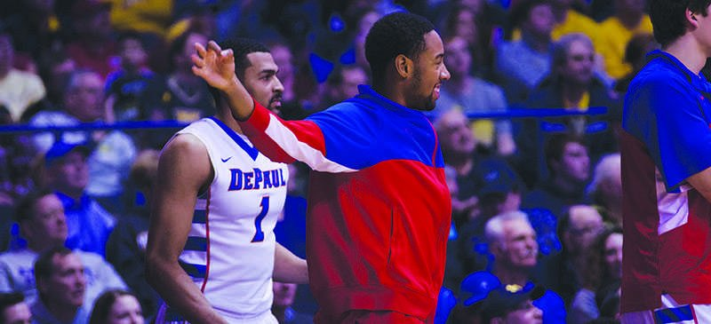 DePaul sophomore R.J. Curington is a student-athlete and supports his team at Allstate Arena against Marquette. (DePaulia File)