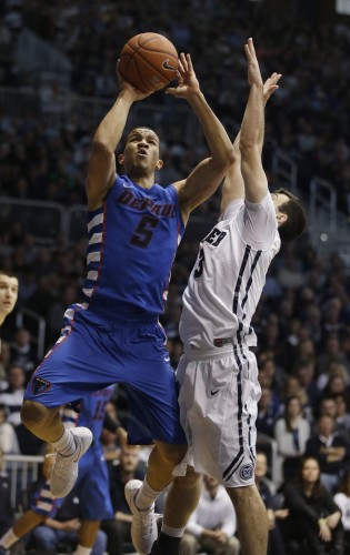 DePaul's Billy Garrett Jr. (5) puts up a shot against Butler's Alex Barlow (3) during the second half of an NCAA college basketball game, Saturday, Feb. 7, 2015, in Indianapolis. Butler won 83-73. (AP Photo/Darron Cummings)