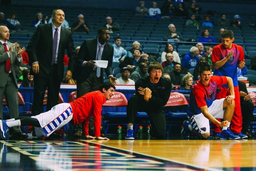 From left: Cory Dolins, Peter Ryckbosch, Joe Hanel, and David Molinari, the Bench Mob, watch as the Blue Demons took on Seton Hall last Tuesday. The Demons won 75-62.