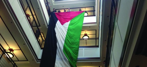A protest at Arts and Letters Hall May 2014 by Students for Justice in Paletine (SPJ). Students wave the Palestinian flag in support of the DePaul Divest movement. (DePaulia File)