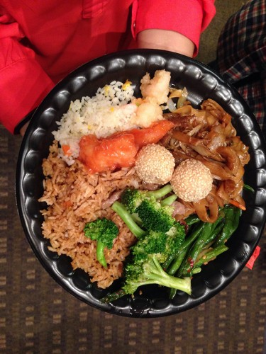 The meal included beef and broccoli, orange chicken, fortune cookies, la dofu, chow main and sesame balls. (Lauren Awtry / The DePaulia)