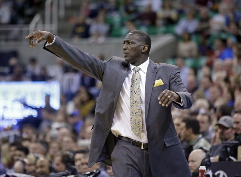Sacramento Kings head coach Tyrone Corbin directs his team in the second quarter during an NBA basketball game against the Utah Jazz Saturday, Feb. 7, 2015, in Salt Lake City. (AP Photo/Rick Bowmer)