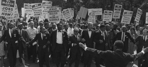 Dr. Martin Luther King Jr. leads a march in 1963. Protests in the 1960s consisted of neighborhoods coming together to make a change. (Wikimedia Commons)