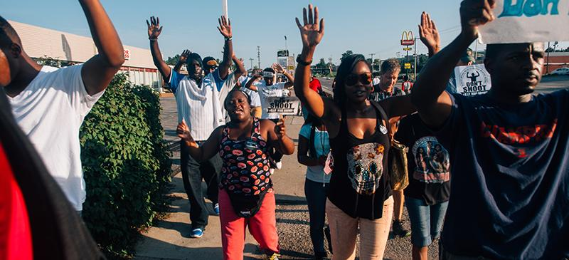 """Hands up, don't shoot,"" became a phrase synonymous with the Ferguson protests after the shooting of Michael Brown in August 2014. (Jamelle Bouie / Wikimedia Commons)"