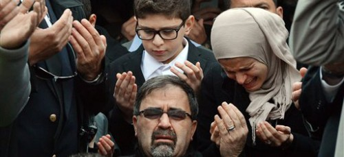 The family of Deah Shaddy Barakat mourns at his funeral. Barakat was one of three Muslims murdered on Feb. 10 in Chapel Hill, N.C. (AP Photo/The News Observer, Chuck Liddy)
