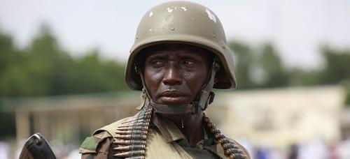 A Nigerian soldier stands guard during Eid al-Fitr prayers in Maiduguri, Nigeria. (Sunday Alamba, File | AP)