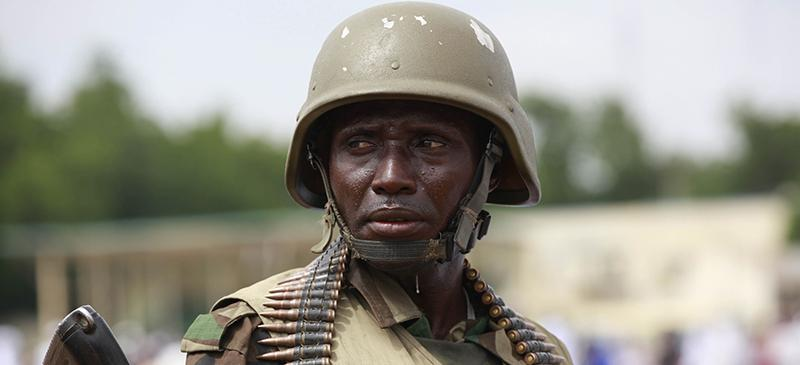 A Nigerian soldier stands guard during Eid al-Fitr prayers in Maiduguri, Nigeria. (Sunday Alamba, File | AP)