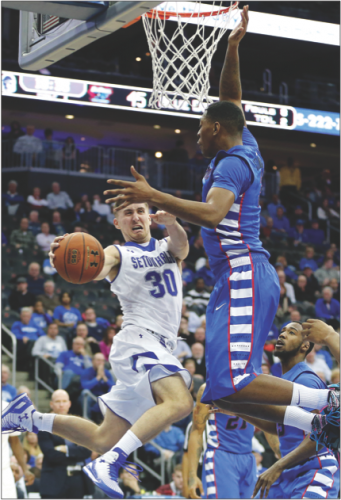 Junior forward Rashaun Stimage displays an impressive vertical in protecting the rim against Seton Hall in a 64-60 win Jan. 22. Stimage missed the first 15 games this season with a broken right foot. (Julio Cortez | AP)