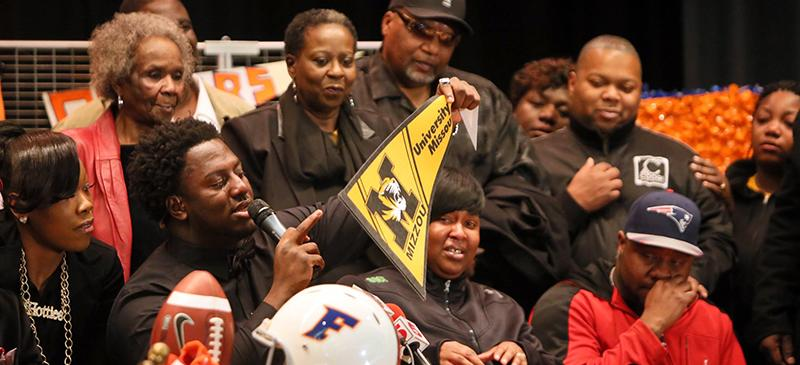 East St. Louis High School defensive lineman Terry Beckner Jr., second from left, announces intentions to attend Missouri during national signing day, Feb. 4, 2015. (Chris Lee | AP)