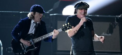 Angus Young, left, and Brian Johnson, of AC/DC, perform at the 57th annual Grammy Awards on Sunday, Feb. 8, 2015, in Los Angeles. (Photo by John Shearer/Invision/AP)