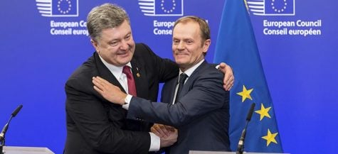 Ukrainian President Petro Poroshenko (left) and European Council President Donald Tusk embrace during the negotiation of a ceasefire between Russia and the Ukraine. (AP Photo/Geert Vanden Wijngaert)